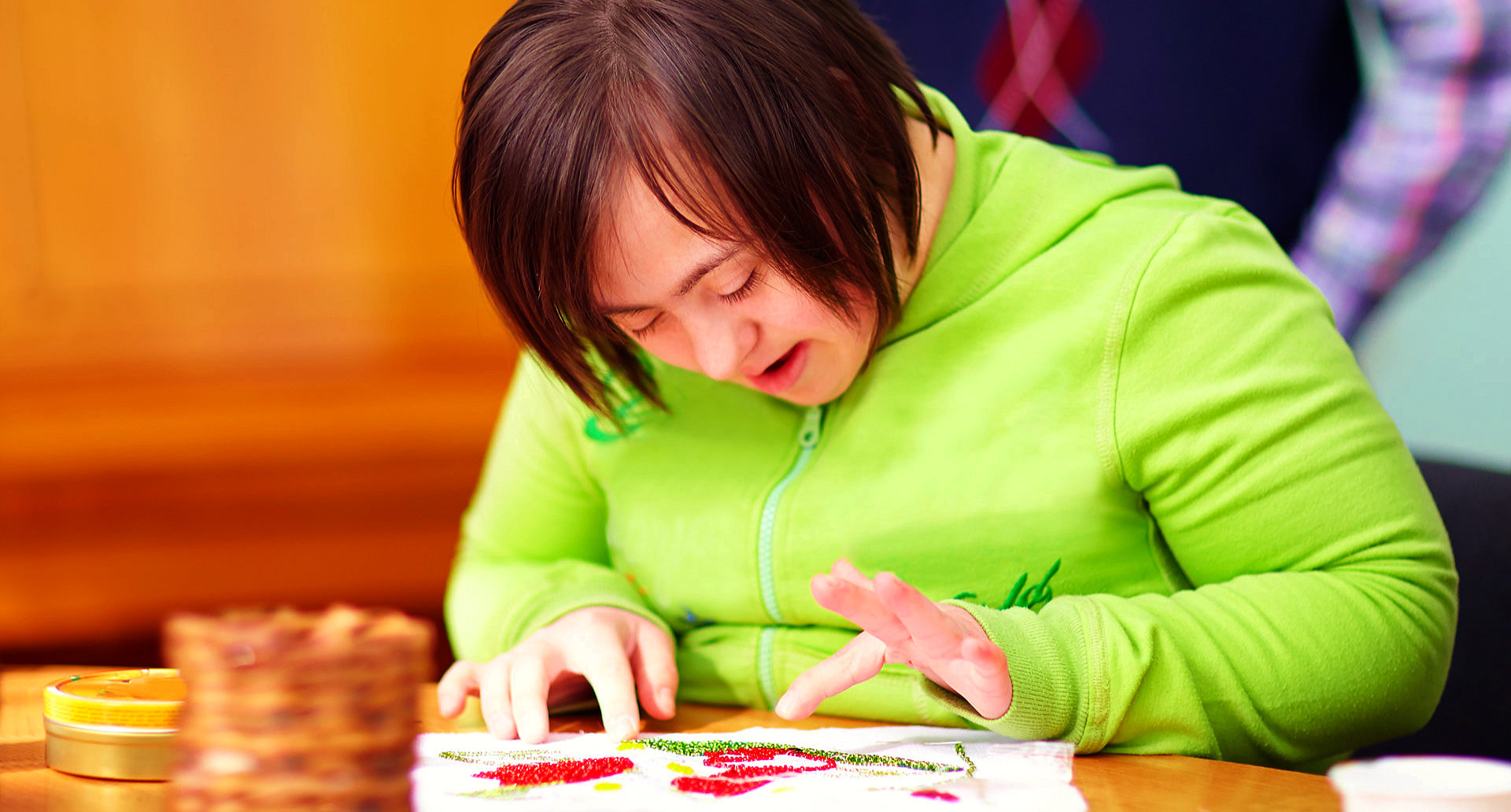 young adult woman engaged in craftsmanship
