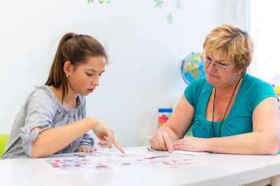 female mentor working with a teenage girl puzzle