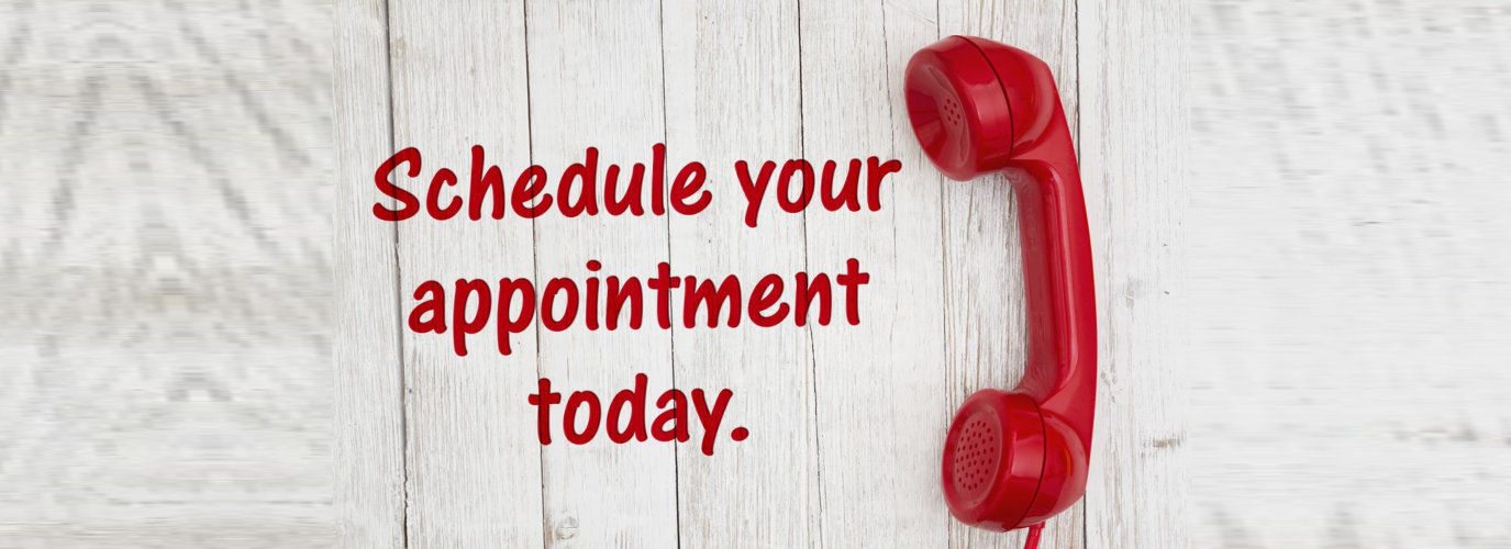 schedule your appointment today text with retro red phone handset on weathered whitewash textured wood